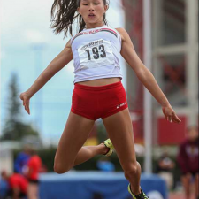 Emma Chong hurls herself into the air while competing in the long jump at the Caltaf Track Classic in Calgary on Saturday, June 20, 2015. by Aryn Toombs / Calgary Herald
